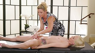 India Summer strips and massages the shaved pussy of Elsa Jean
